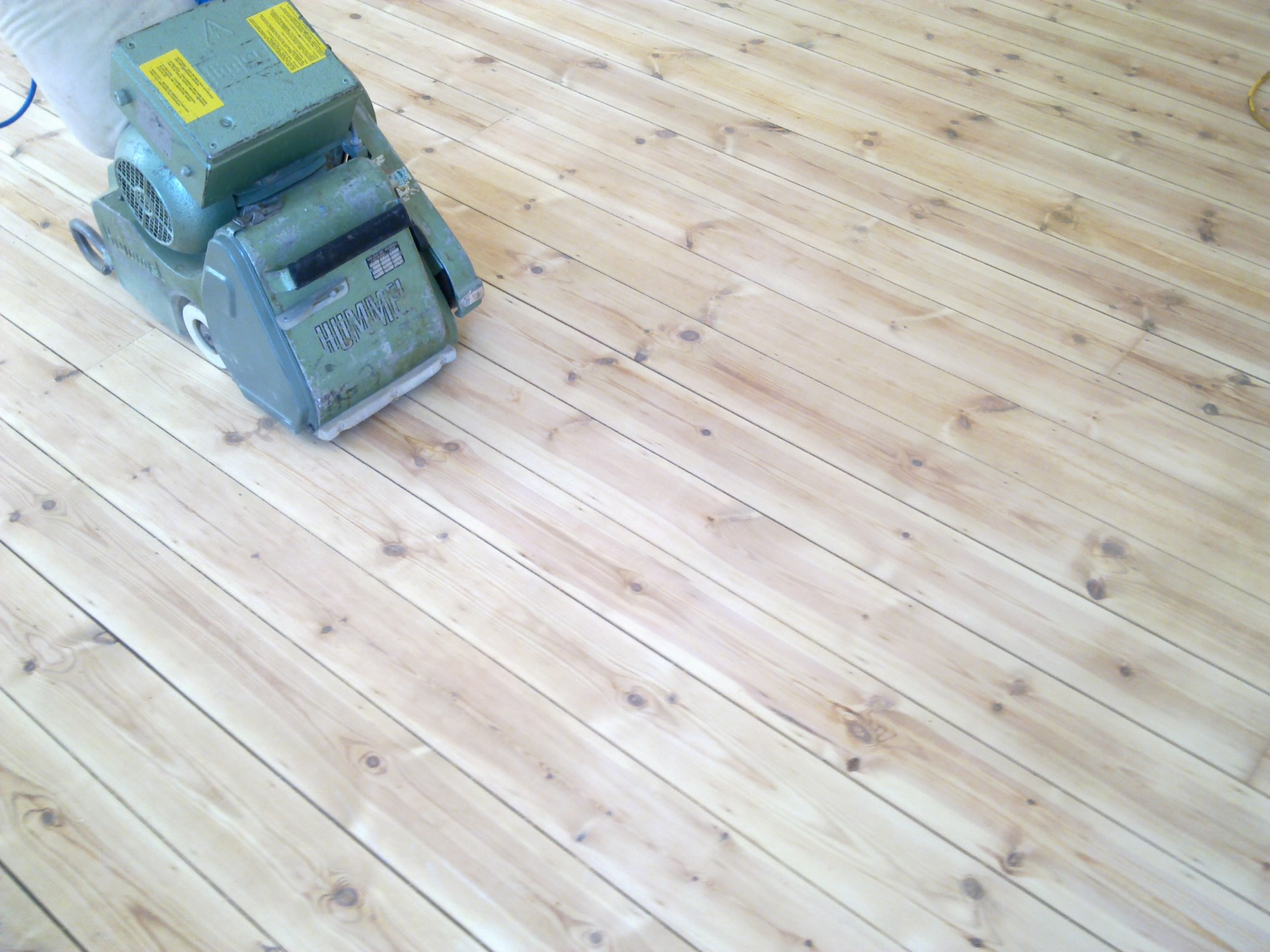 Pine floorboards after initial sanding