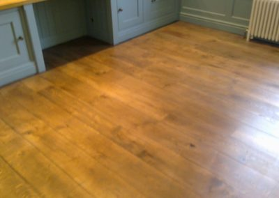 Solid oak floor with light oak dye applied