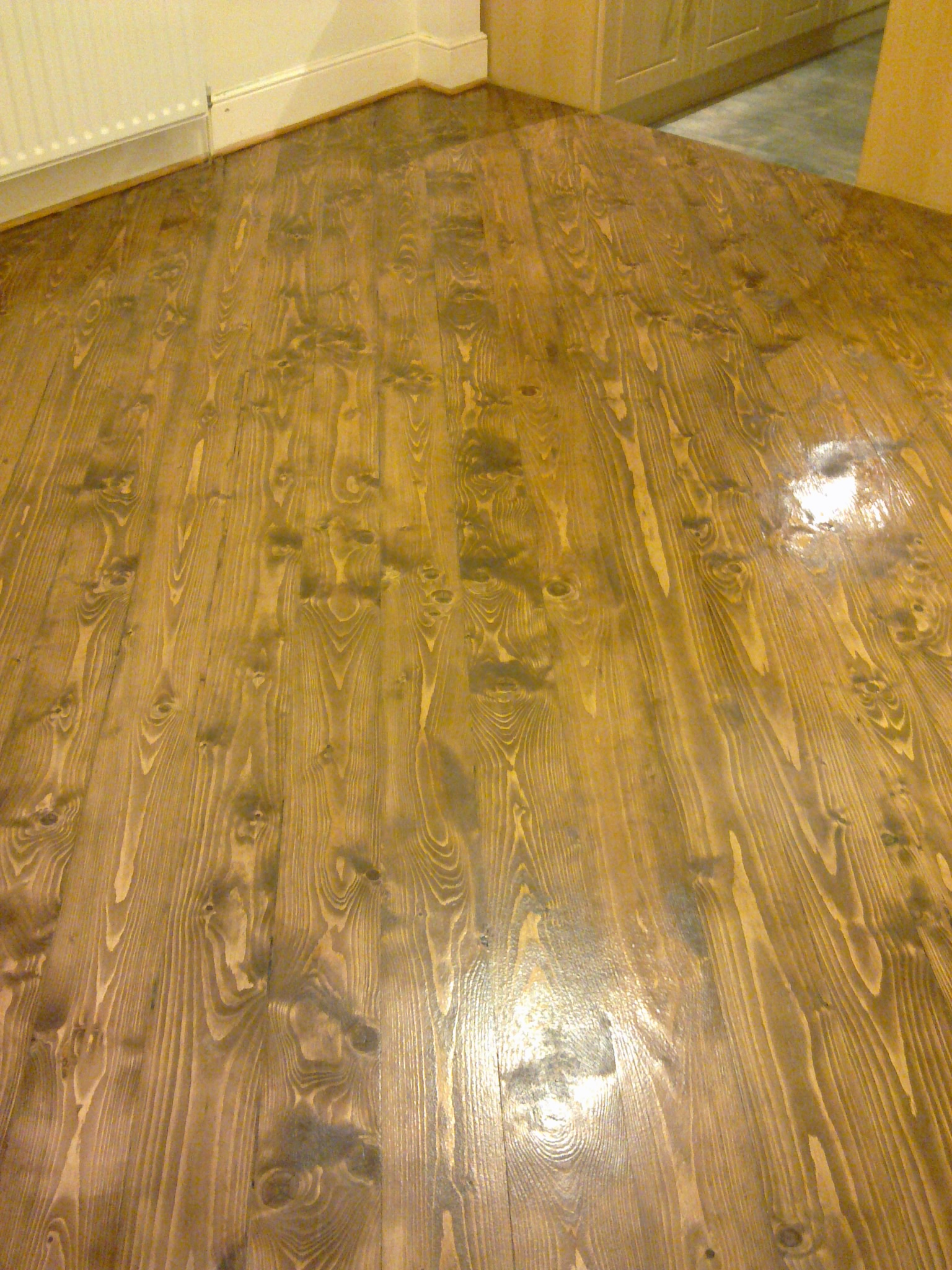 Pine floor with wood dye applied