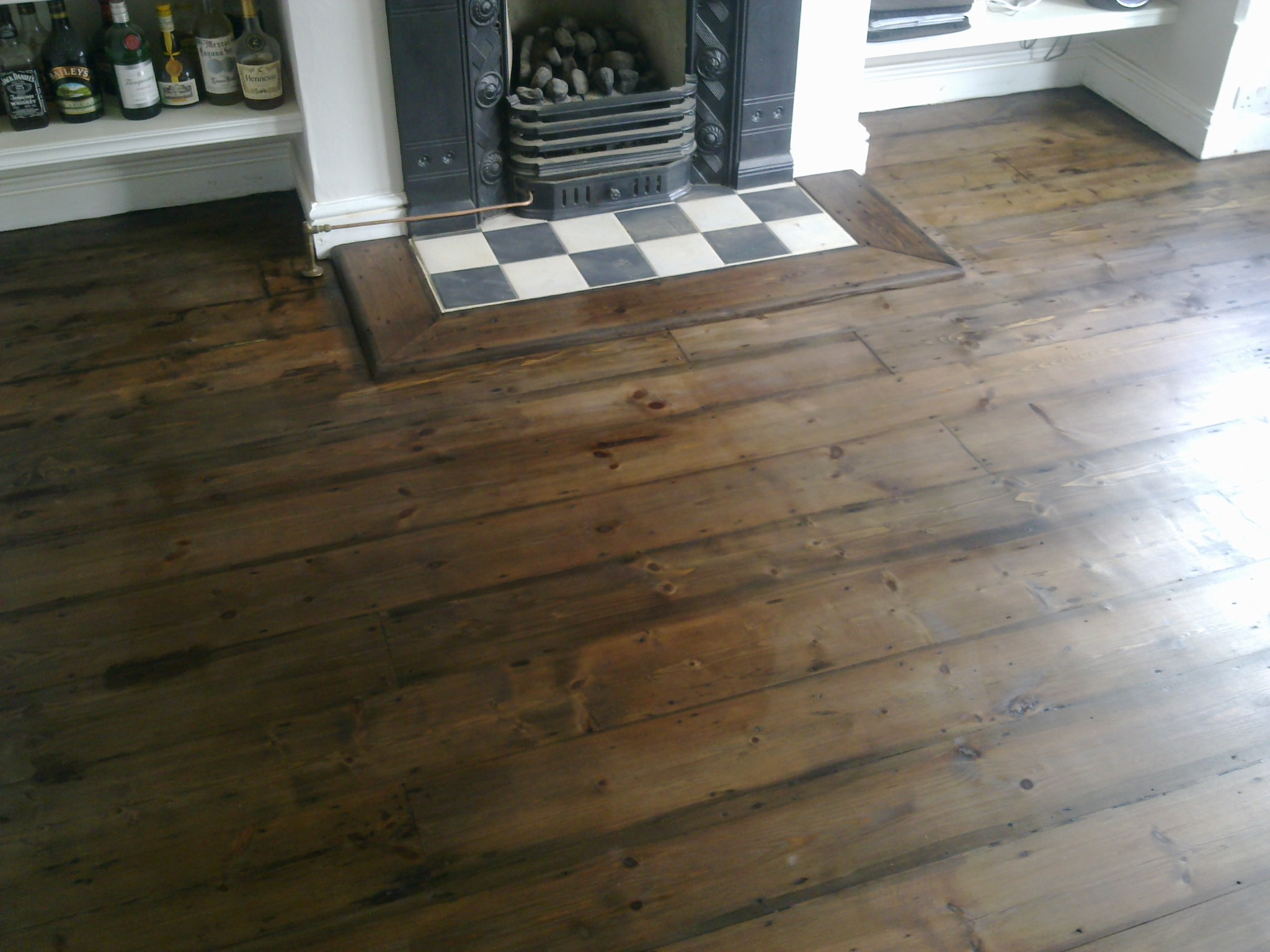 Original pine floor with dark wood dye and two coats of varnish.