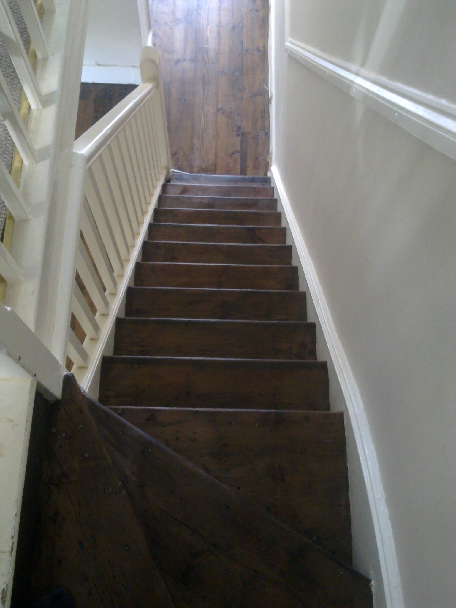 Original staircase sanded down, coloured with dark oak wood dye and sealed with two coats of clear varnish.