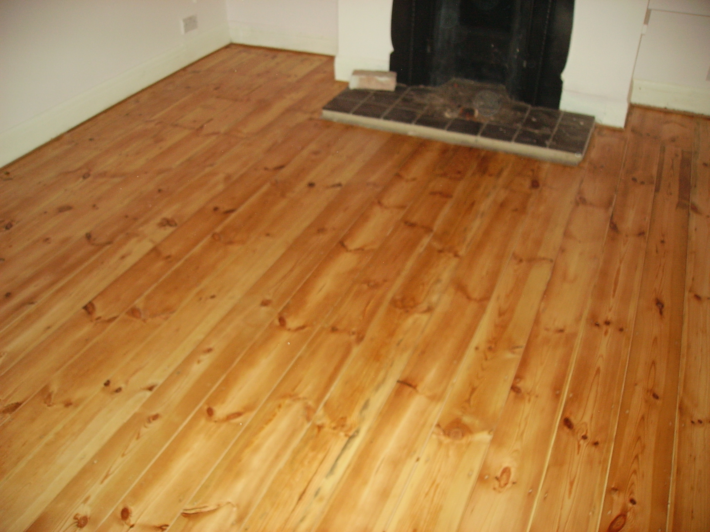 Original pine flooring - gaps filled with larch slivers, sanded and varnished.